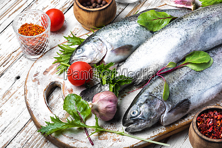 raw trout on cutting board