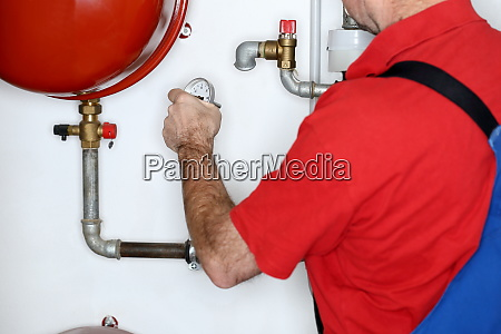 plumber is working in a heating