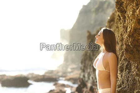 sunbather breathing fresh air on the