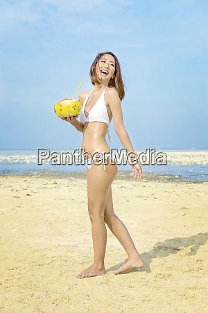 asian sexy girl in bikini holding