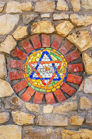 mosaic star of david on stone
