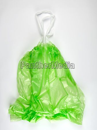 empty transparent green plastic garbage