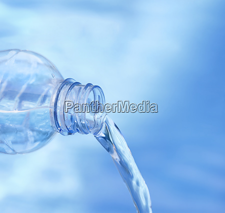 blue plastic bottle pouring water
