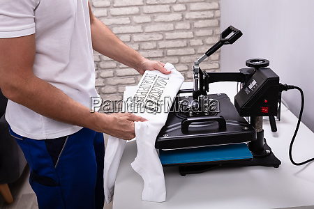printing on t shirt in workshop