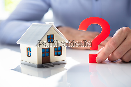 question mark next to house model