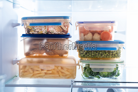 containers with various food in refrigerator