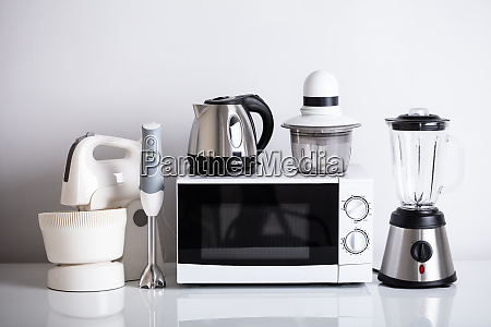 kitchen appliances on white desk