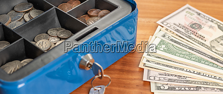 a cash box with bills and