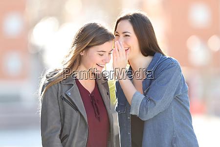 gossip woman telling secret to her