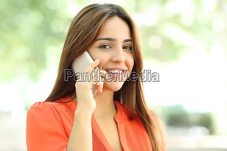 happy woman is talking on phone