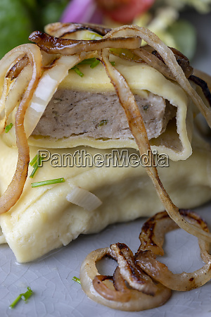 swabian maultasche with onions on a