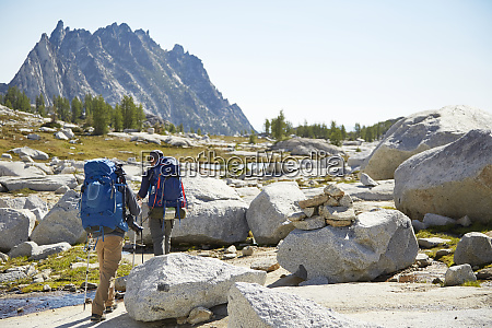 hikers backpacking in rocky rural landscape
