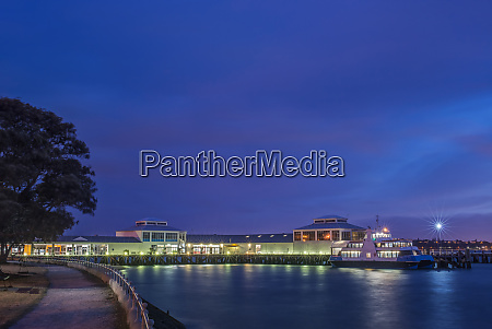 harbor and boat lit up at