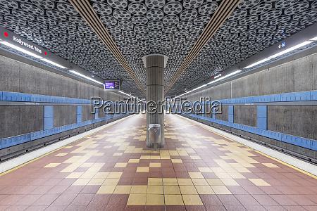 movie reels on ceiling in subway