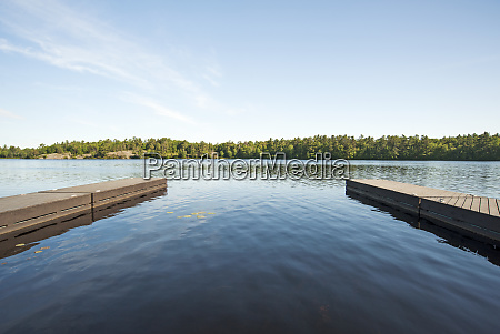 wooden docks over still river in