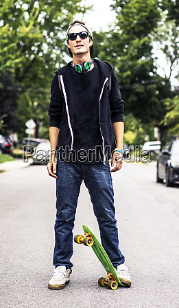 caucasian man with headphones standing on