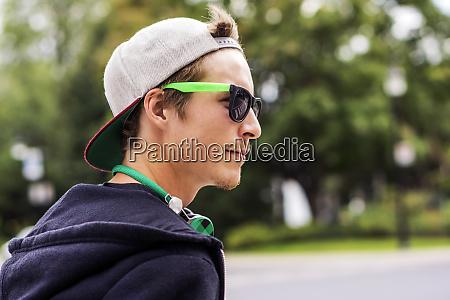 caucasian man wearing sunglasses and headphones