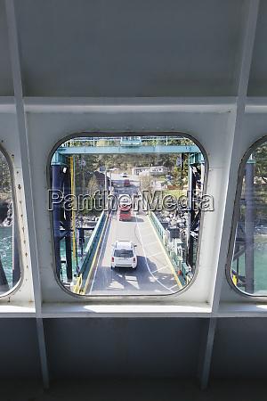 bridge viewed through ferry boat window