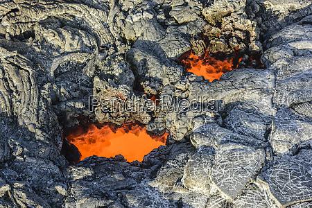 molten lava glowing near dried lava