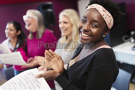 happy woman singing in choir in