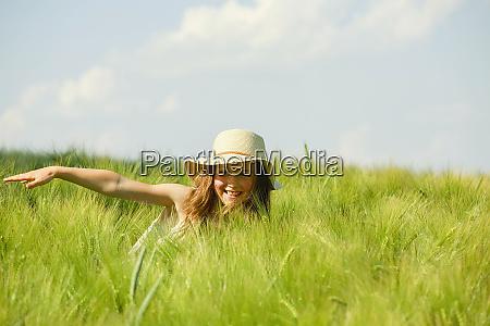 carefree happy girl in sunny rural