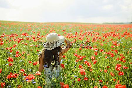 girl walking in sunny rural red