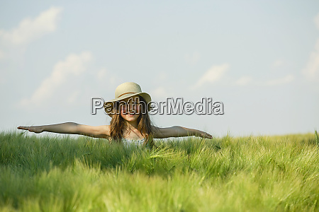 portrait carefree girl with arms outstretched