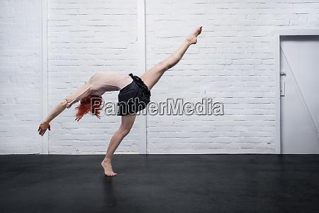 graceful modern female dancer performing