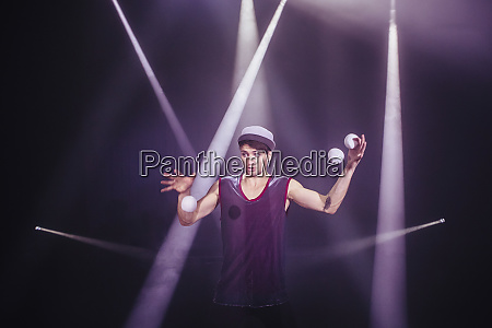 male performer juggling on stage