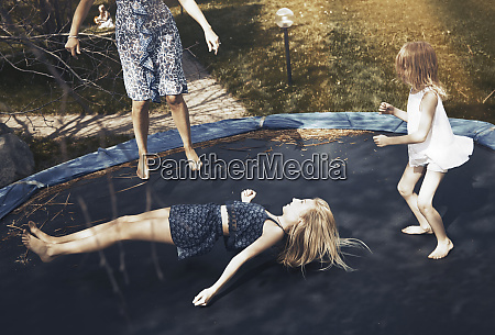 happy family jumping on trampoline