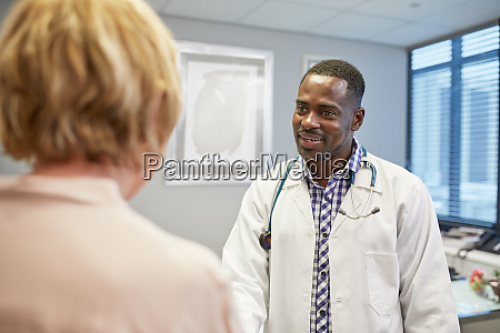 male doctor talking to senior female
