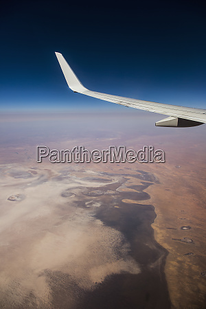 aerial view airplane wing over landscape