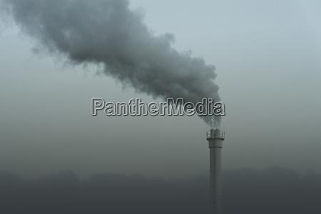smokestack emitting smoke neukoelln berlin germany