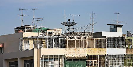 apartment building with satellite dish