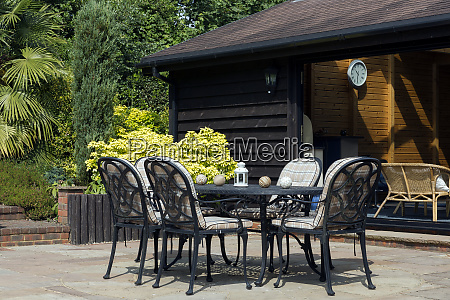table and chairs on back porch