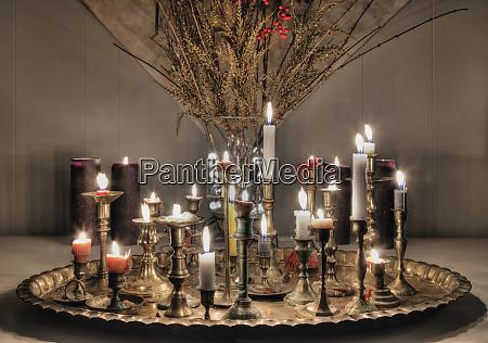 candles burning on metal platter