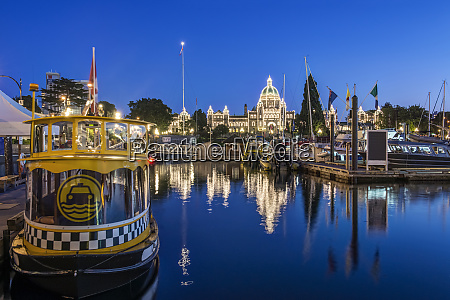 parliament buildings and harbor illuminated at