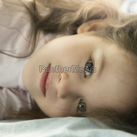 portrait of girl lying down