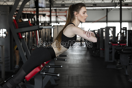young woman doing reverse sit ups