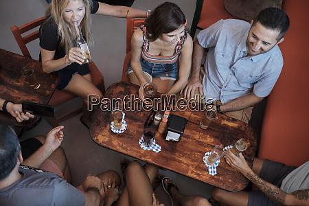 friends socializing in a bar