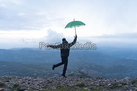 man jumping for joy on a