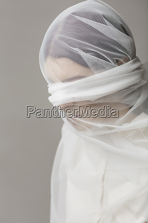 blindfold woman wrapped in a veil