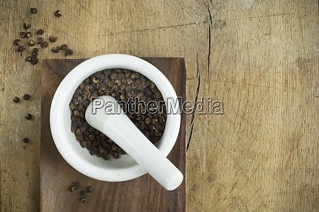 szechuan pepper on mortar