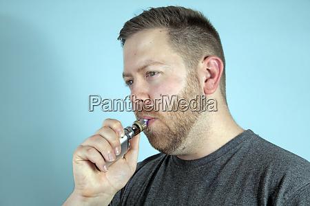 young man vaping smoking an e