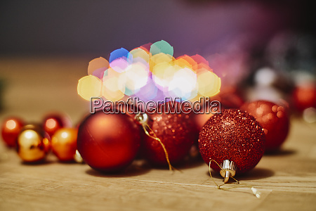 red christmas baubles on wooden floor