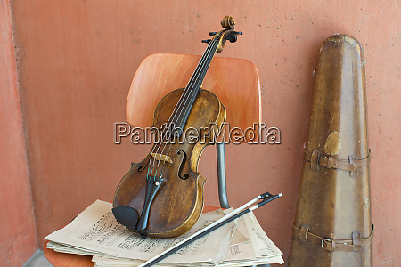 violin bow and sheet music on