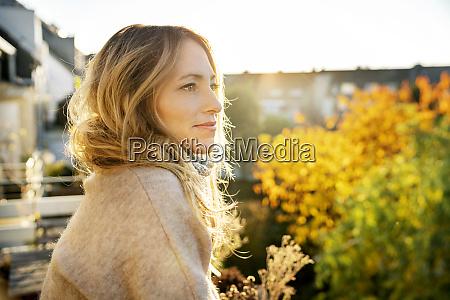blond mature woman enjoying sunny autumnal