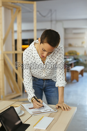 woman working on draft at desk
