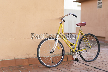 bicycle leaning against house wall