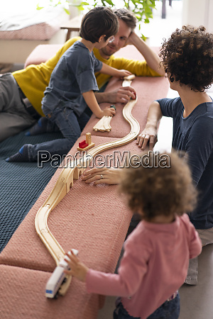 happy family playing with their kids